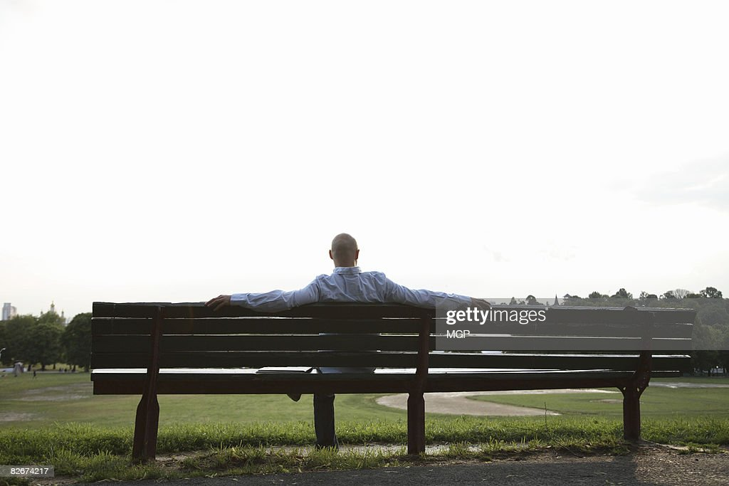man on park bench : Stock Photo