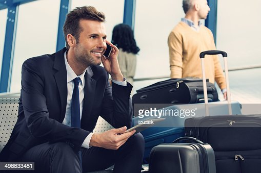 Man on phone at the airport