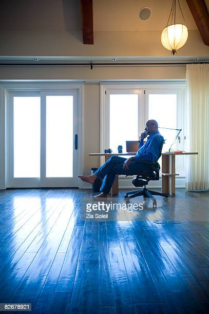 Man on phone in his home