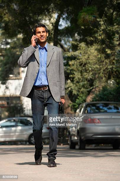 man on phone walking with briefcase