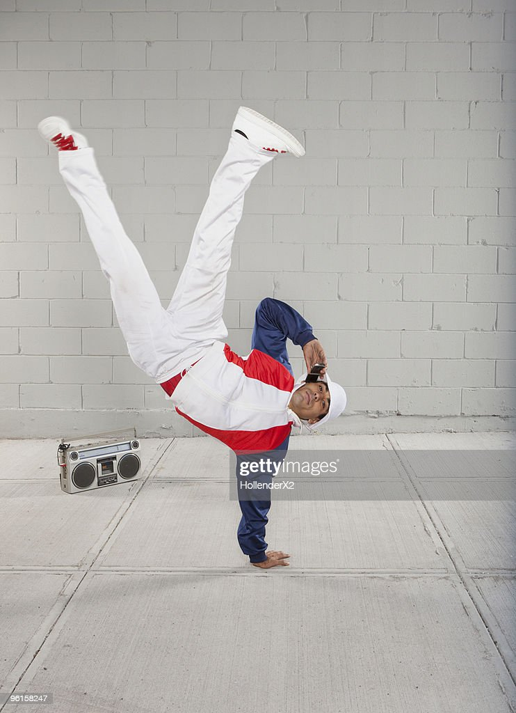 man on phone while breakdancing : Stock Photo