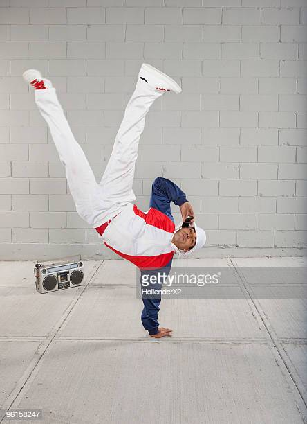 man on phone while breakdancing