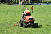 Man on Ride-On mower cutting grass