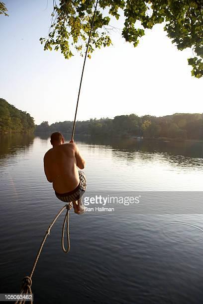 Man on rope swing