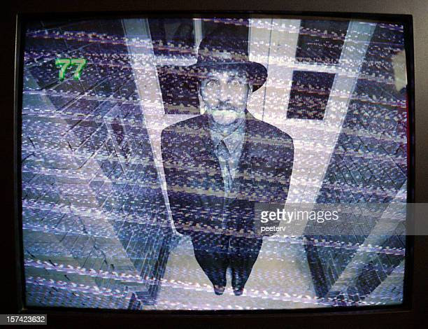 man on security monitor