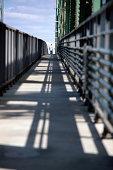 Man on shadowed boardwalk