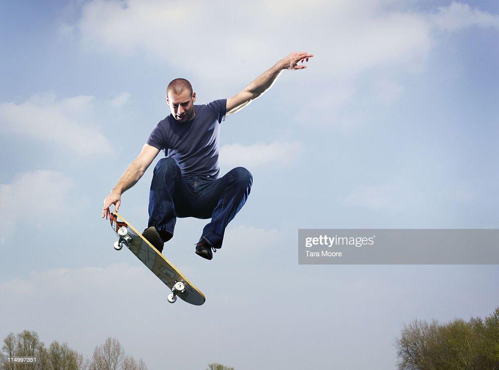 man on skateboard in mid air