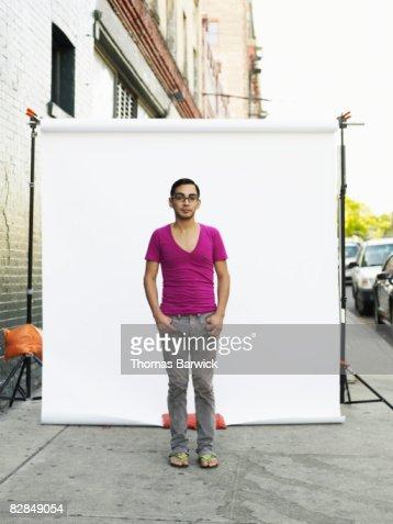 Man on standing on sidewalk, portrait