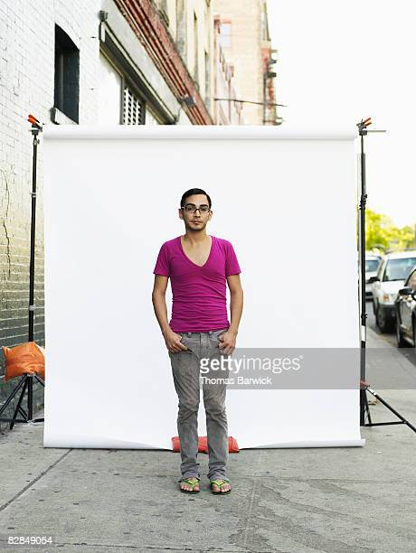 Man on standing on sidewalk, portrait