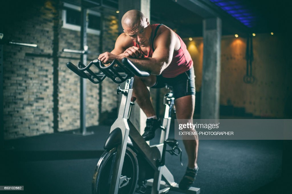 Man on stationary bicycle : Stock Photo