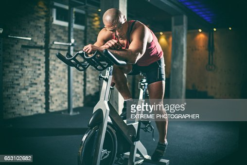 Man on stationary bicycle : Stock-Foto