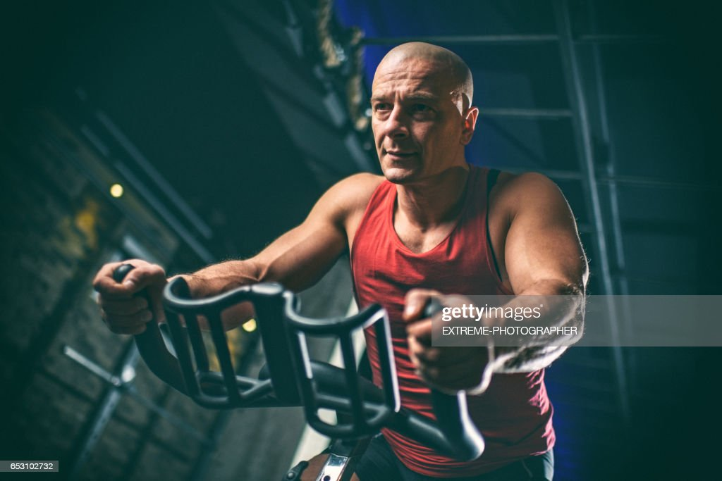 Man on stationary bicycle : Photo