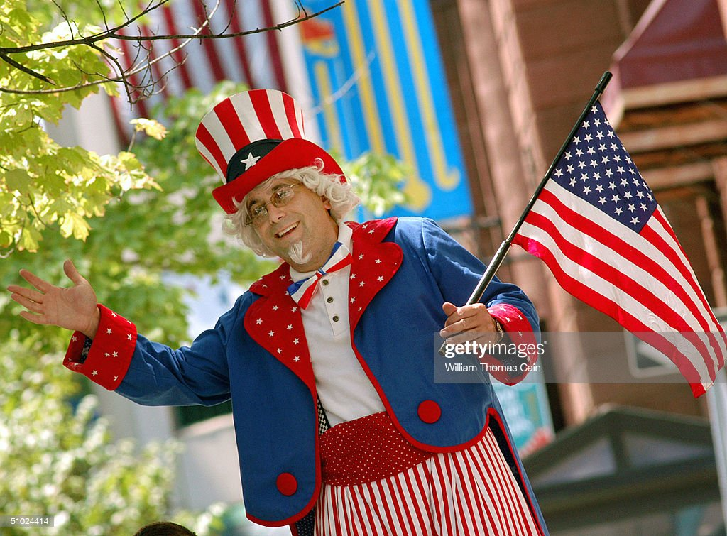 A man on stilts dressed as 'Uncle Sam' entertains tourists on the street after Afghan President Hamid Karzai accepted the 2004 Philadelphia Liberty...