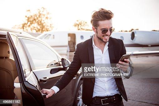 Man on the airport opening car door