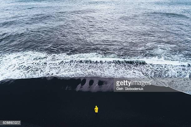 Man on the back sand beach