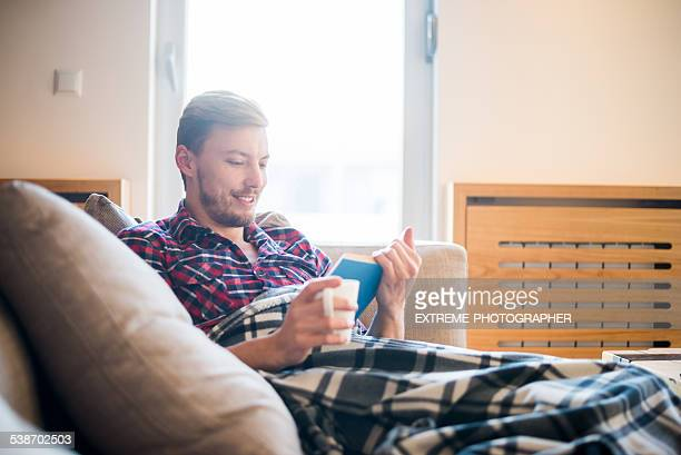 Man on the couch reading a book