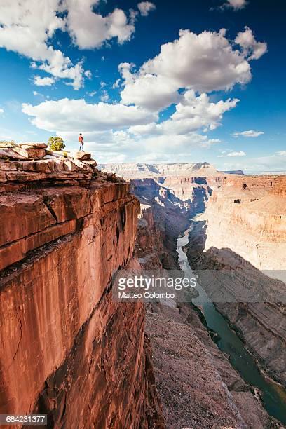 Man on the edge of overlook on Grand Canyon, USA