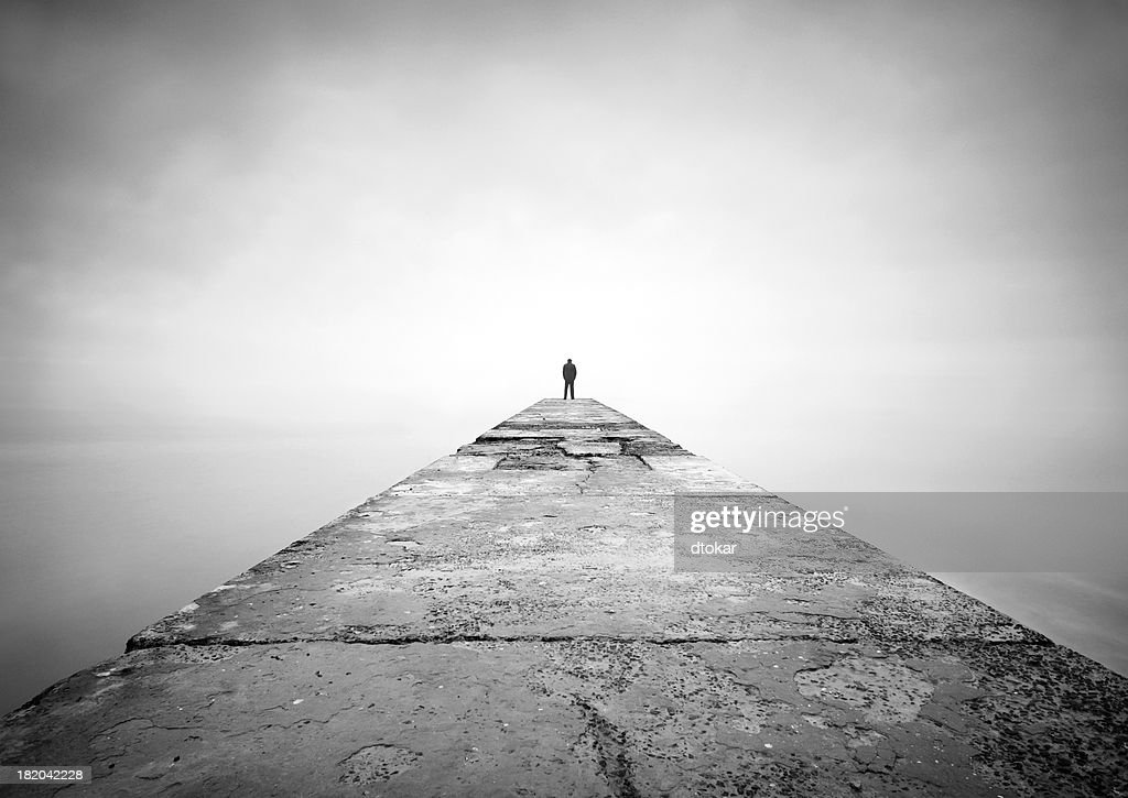 Man on the edge of pier : Stock Photo