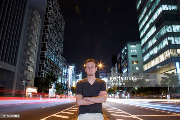Man on the urban road at night
