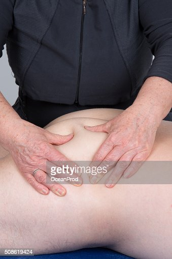 Man on  therapy massage procedure by physiotherapist : Stock Photo