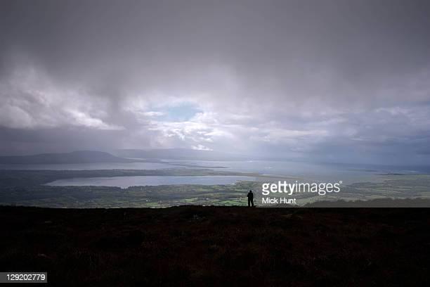 Man on top of Benbulben mountain