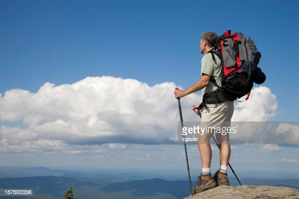 Man on top of mountain peak