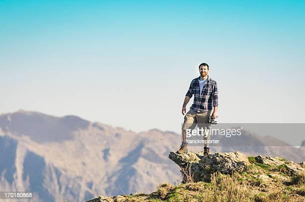 Mann an der Spitze des peak