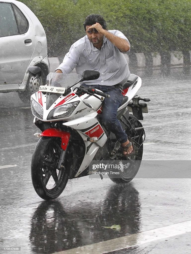 A man on two-wheeler gets drenched during the heavy pre monsoon rain on June 14, 2013 in New Delhi, India. The city received 11.6 mm rainfall and the humidity oscillated between 47 and 91 percent.