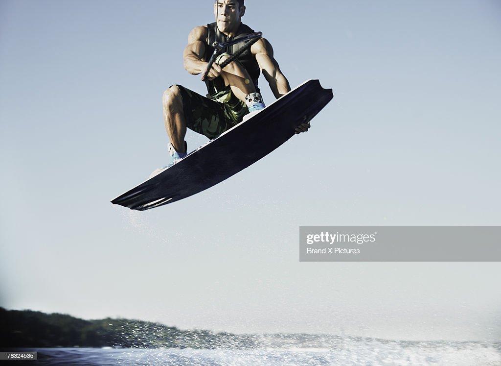 Man on wake board in midair : Stock Photo