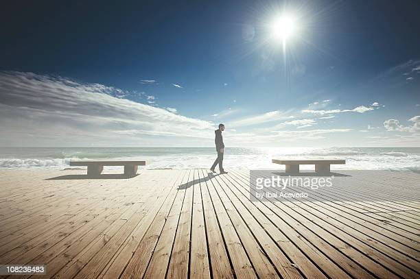 Man on walking on beach