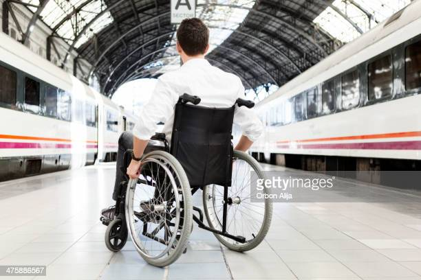 Man on wheel chair waiting for the train