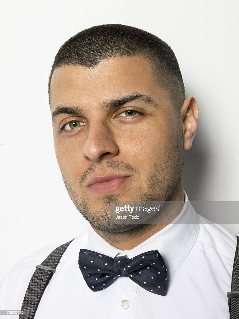 man on white with bowtie and suspenders : Stock Photo