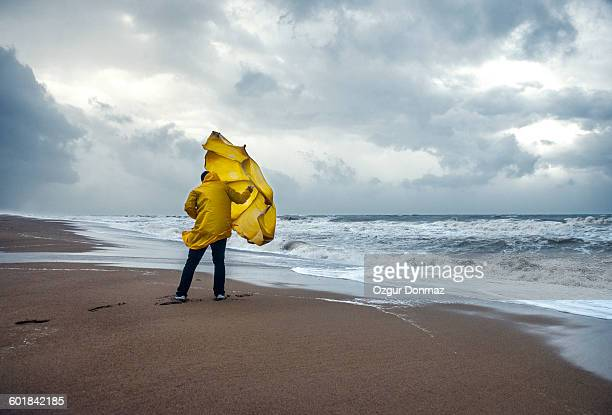 Man on windy beach