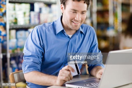 Man online shopping with credit card : Stock Photo