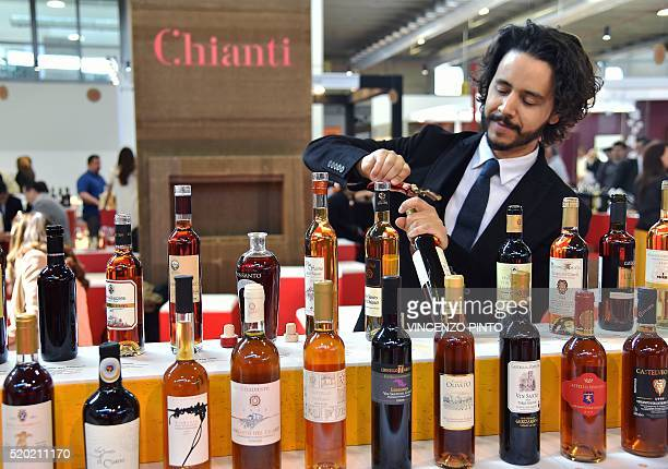 A man open a bottle of wine on April 10 2016 during the 50th edition of the Vinitaly wine exhibition in Verona Vinitaly is the worlds largest wine...