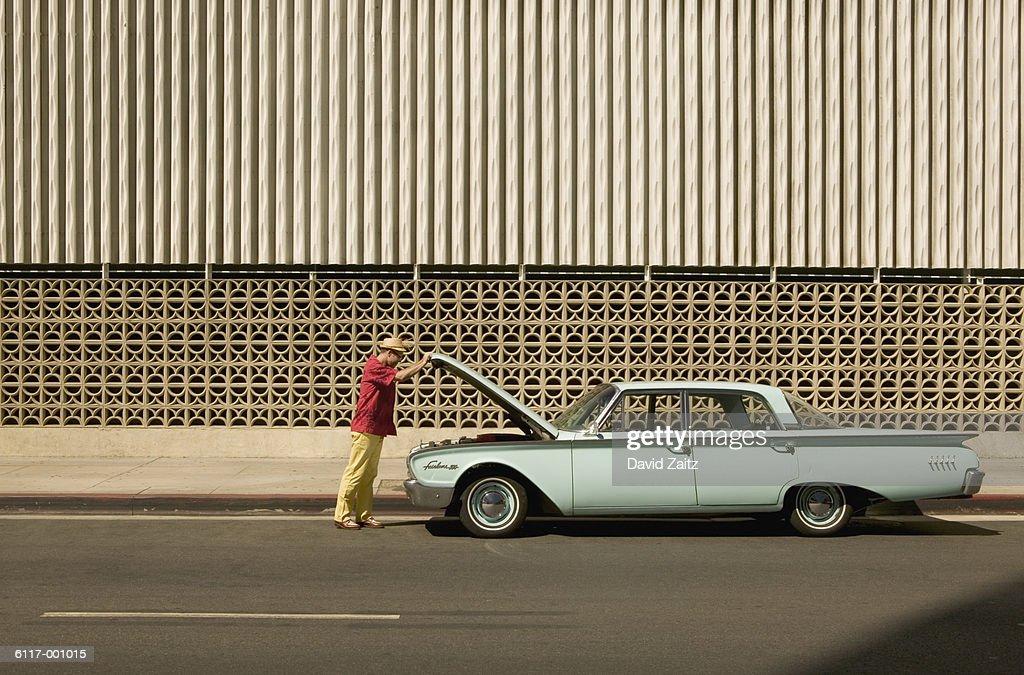 Man Opening Automobile Hood