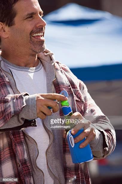 Man opening beer bottle