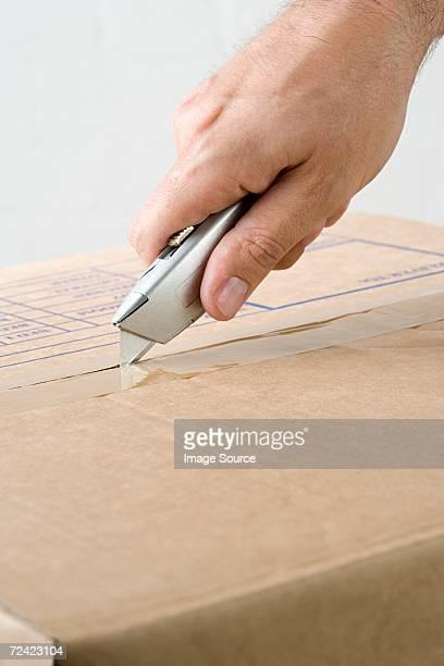 Man opening box