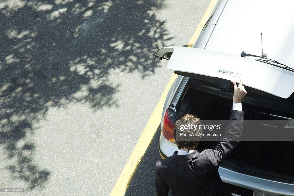 Man opening car hatchback