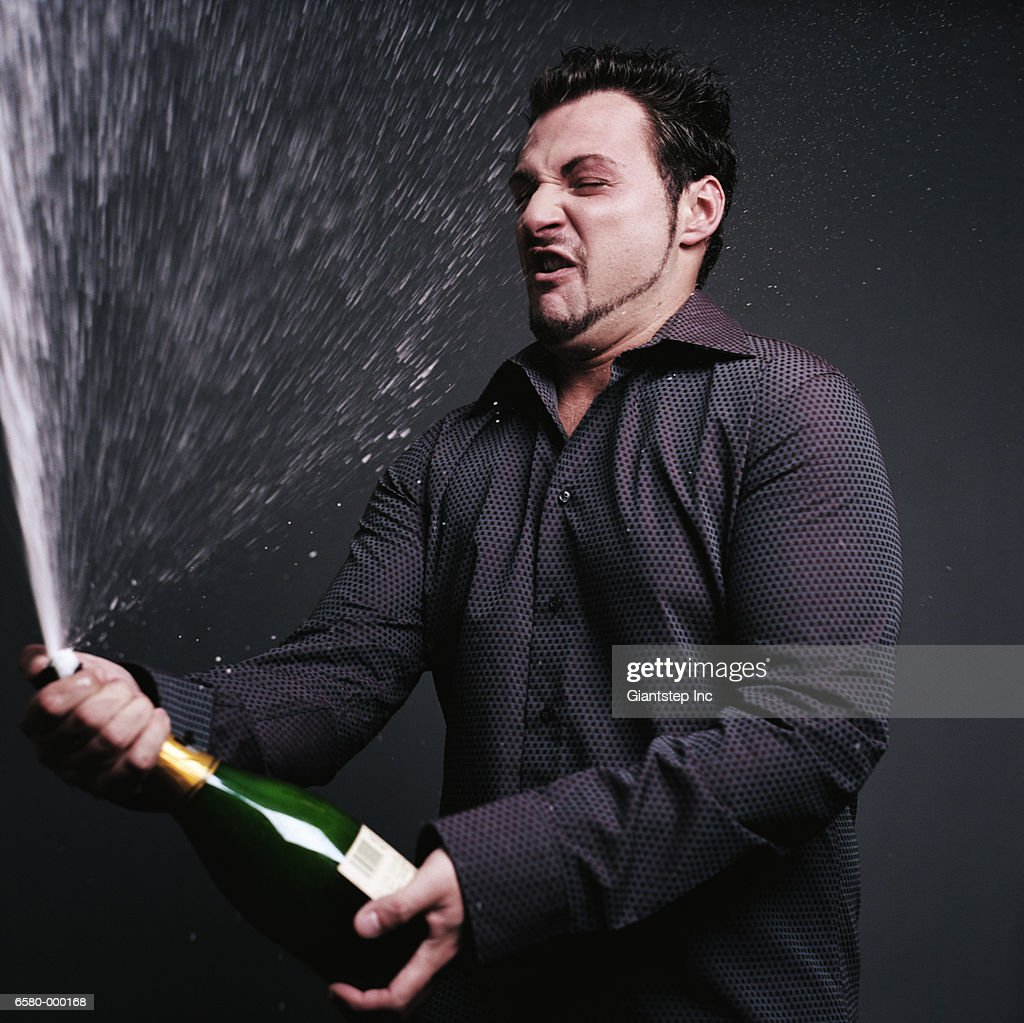 Man Opening Champagne : Stock Photo