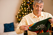 Man opening Christmas present