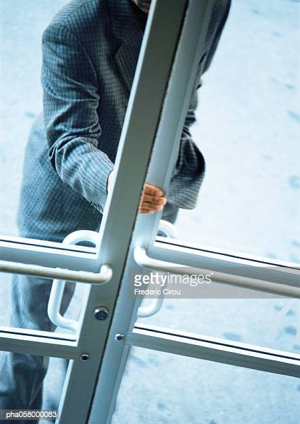 Man opening door, partial view, high angle view