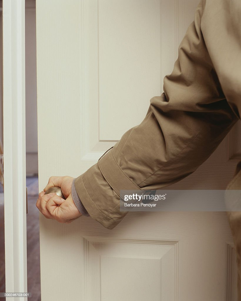 Man opening door, (Mid section) : Stock Photo
