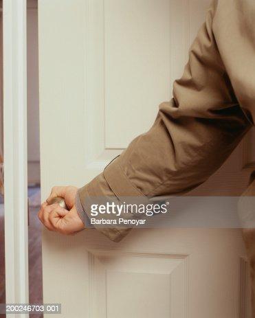 Man opening door, (Mid section) : Stock Photo