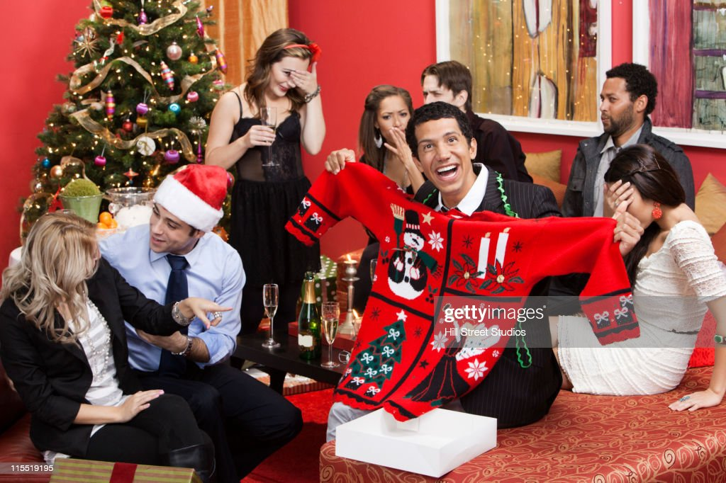 Man opening gift at Christmas party : Stock Photo