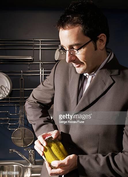 Man Opening Jar of Pickles