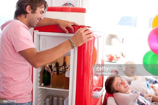 Man opening refrigerator