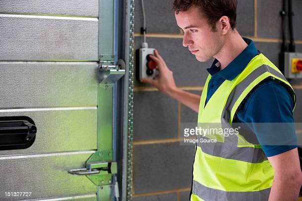 Man opening warehouse doors