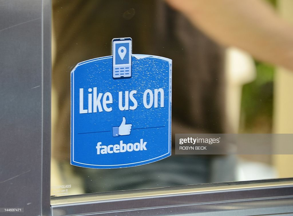 A man opens the door of Building 10 at Facebook headquarters in Menlo Park, California, May 15, 2012. Facebook, the word's most popular social networking website, expects to raise USD 12.1 billion in what will be Silicon Valley's largest-ever initial public offering (IPO) later this week.