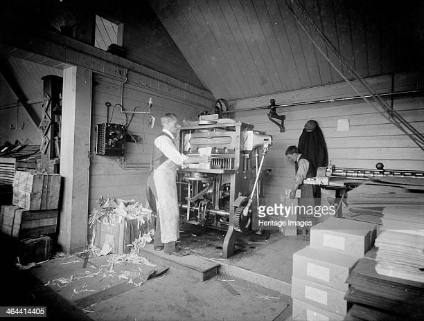 A man operates a printing press at the Church Army Press Oxford Oxfordshire c1860c1922